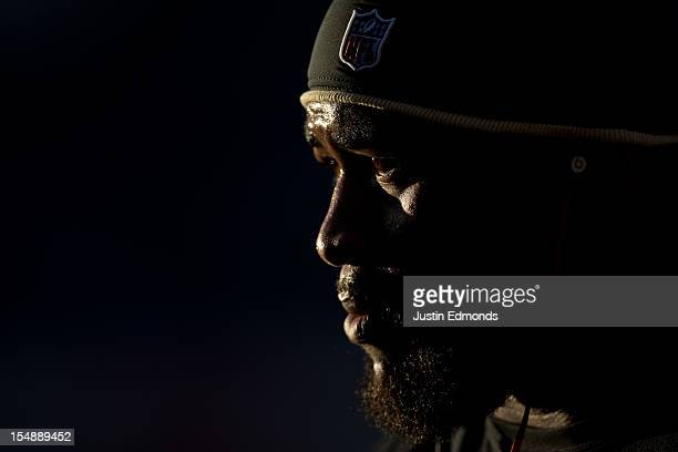 Defensive end Junior Galette of the New Orleans Saints warms up before a game against the Denver Broncos at Sports Authority Field Field at Mile High...