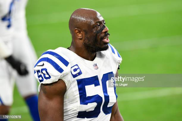 Defensive end Justin Houston of the Indianapolis Colts stands on the sideline in the second half of their game against the Las Vegas Raiders at...