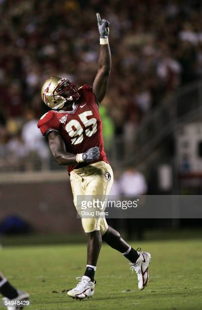 Defensive end Kamerion Wimbley of the Florida State Seminoles celebrates a sack of quarterback Kyle Wright of the Miami Hurricanes at Doak Campbell...