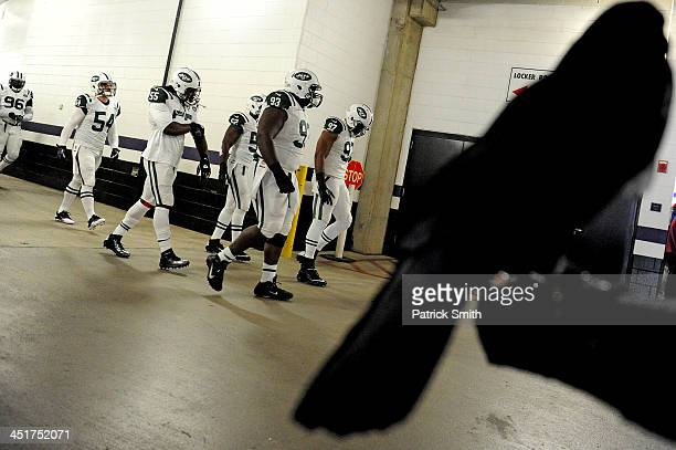 Defensive end Kenrick Ellis of the New York Jets and teammates take the field for warmups before playing the Baltimore Ravens at MT Bank Stadium on...