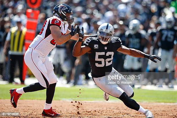 Defensive end Khalil Mack of the Oakland Raiders is defended by tight end Jacob Tamme of the Atlanta Falcons during the first quarter at...