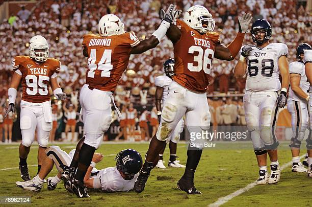 Defensive end Lamarr Houston and Rashad Bobino of the Texas Longhorns celebrate after sacking quarterback Chase Clement of the Rice Owls in the...