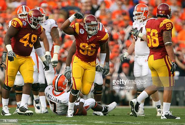 Defensive end Lawrence Jackson of the USC Trojans celebrates a defensive play on quarterback Juice Williams of the Illinois Fighting Illini in the...