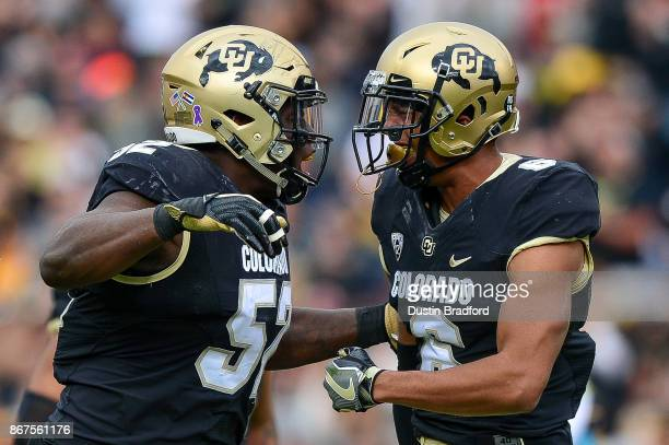 Defensive end Leo Jackson III and defensive back Evan Worthington of the Colorado Buffaloes celebrate a defensive play against the California Golden...