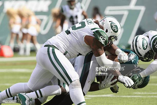 Defensive End Leonard Williams of the New York Jets makes a stop against the Philadelphia Eagles at MetLife Stadium on September 27 2015 in East...