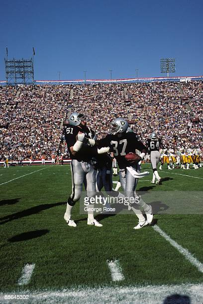 Defensive end Lester Hayes and linebacker Bob Nelson of the Los Angeles Raiders celebrates after a play during the 1983 AFC Divisional Playoffs game...