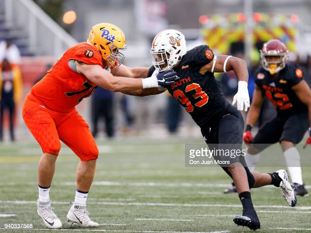 Defensive End Marcus Davenport of the TexasSan Antonio on the South Team is defended by Tackle Brian O'Neil of Pittsburgh on the North Team during...