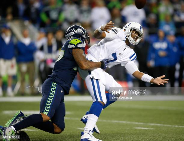 Defensive end Marcus Smith of the Seattle Seahawks causes Jacoby Brissett of the Indianapolis Colts to fumble in the third quarter of the game at...