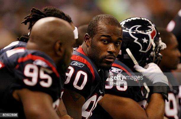 Defensive end Mario Williams of the Houston Texans rests on the bench while taking on the New Orleans Saints during a pre-season game at Louisiana...