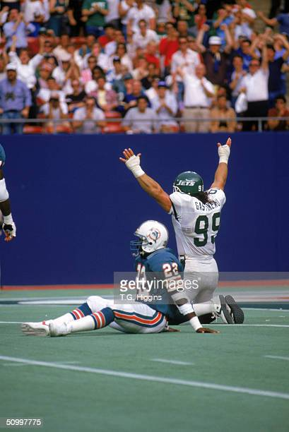 Defensive end Mark Gastineau of the New York Jets celebrates after a play during the game against the Miami Dolphins in 1986 at Giants Stadium in the...