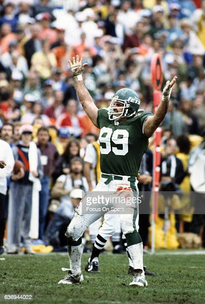Defensive end Mark Gastineau of the New York Jets celebrates after making a play against the Miami Dolphins during an NFL football game circa 1982 at...