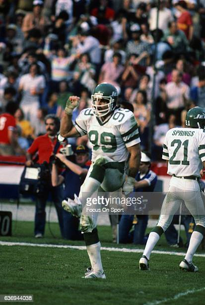 Defensive end Mark Gastineau of the New York Jets celebrates after making a play against the Los Angeles Raiders during an AFC divisional playoff...