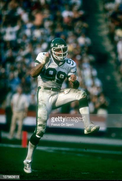 Defensive end Mark Gastineau of the New York Jets dances in celebration after making a play against the Los Angeles Raiders during an NFL/AFC...