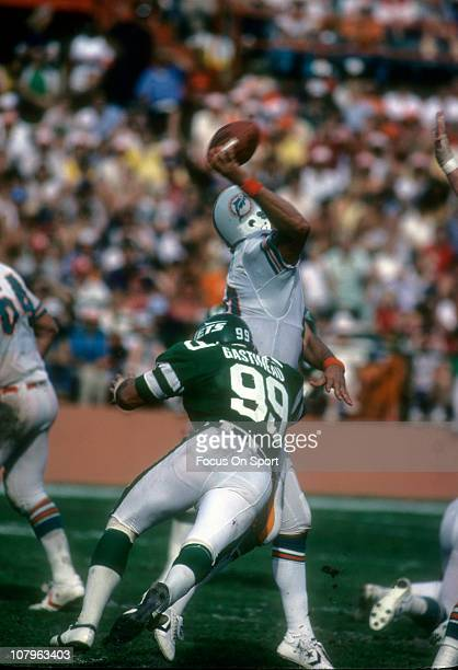 Defensive end Mark Gastineau of the New York Jets in action against the Miami Dolphins during an NFL football game at the Orange Bowl circa 1982 in...
