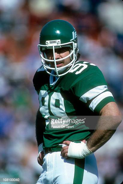 Defensive end Mark Gastineau of the New York Jets in this portrait standing on the field in between plays against the Miami Dolphins circa 1983...