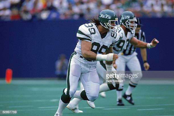 Defensive end Mark Gastineau of the New York Jets runs on the field during a game against the Houston Oilers on September 18 1988 at Giants Stadium...