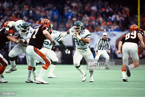 Defensive end Mark Gastineau of the New York Jets rushes the quarterback against the Cincinnati Bengals during an NFL football game circa 1985 at...