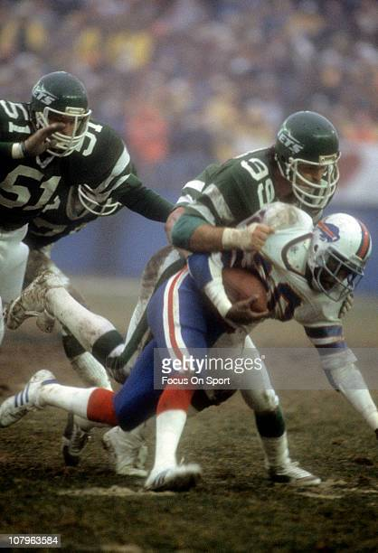 Defensive end Mark Gastineau of the New York Jets tackles running back Joe Cribbs of the Buffalo Bills during the NFL/AFC Wildcard playoff football...