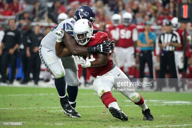 Defensive end Markus Golden of the Arizona Cardinals battles through the block of offensive lineman Germain Ifedi of the Seattle Seahawks during an...
