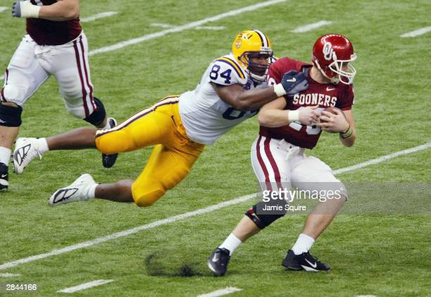 Defensive end Marquise Hill of LSU sacks quarterback Jason White of Oklahoma in the second quarter during the Nokia Sugar Bowl National Championship...