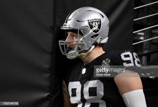 Defensive end Maxx Crosby of the Las Vegas Raiders waits to take the field for a game against the Los Angeles Chargers at Allegiant Stadium on...