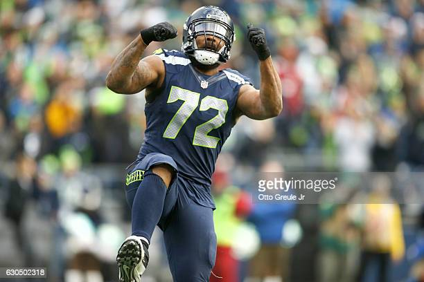 Defensive end Michael Bennett of the Seattle Seahawks celebrates after a play against the Arizona Cardinals at CenturyLink Field on December 24 2016...