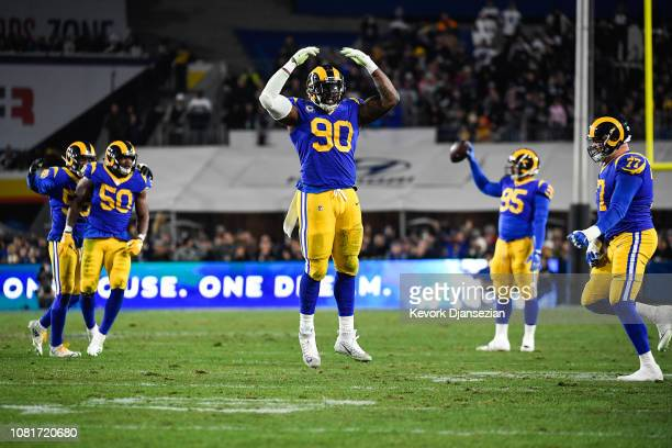 Defensive end Michael Brockers of the Los Angeles Rams celebrates after stopping the Dallas Cowboys' fourth down in the fourth quarter of the NFC...