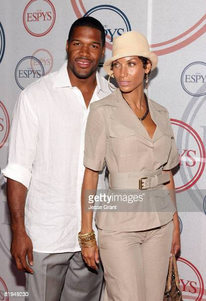NFL defensive end Michael Strahan and Nicole Murphy arrive at the 2008 ESPYs Giant Event Hosted by Eli Manning held at J Bar and Lounge on July 15...