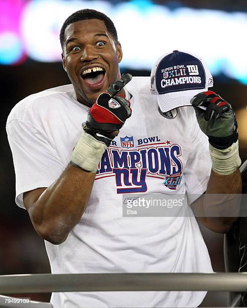 Defensive end Michael Strahan of the New York Giants celebrates after defeating the New England Patriots 1714 during Super Bowl XLII on February 3...