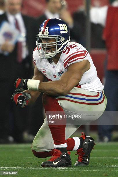 Defensive end Michael Strahan of the New York Giants reacts after sacking quarterback Tom Brady of the New England Patriots in the third quarter...