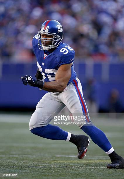Defensive End Michael Strahan of the New York Giants rushes the passer against the New Orleans Saints on December 24, 2006 at Giants Stadium in East...