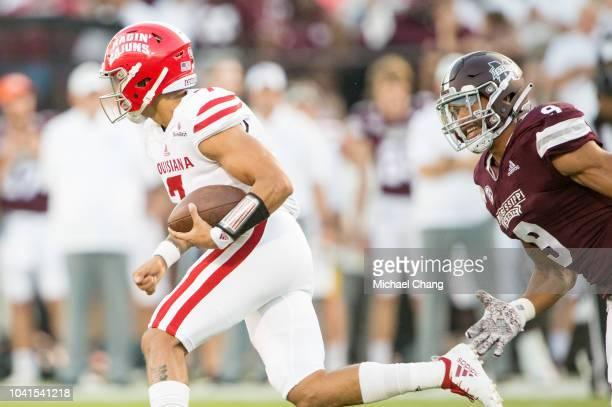 Defensive end Montez Sweat of the Mississippi State Bulldogs looks to tackle quarterback Andre Nunez of the LouisianaLafayette Ragin Cajunson...