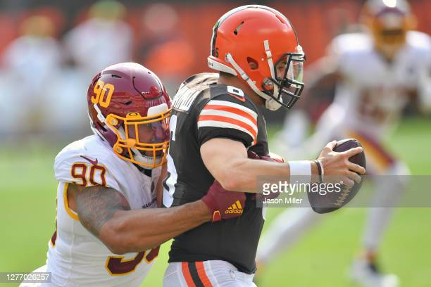 Defensive end Montez Sweat of the Washington Football Team nearly sacks quarterback Baker Mayfield of the Cleveland Browns at FirstEnergy Stadium on...