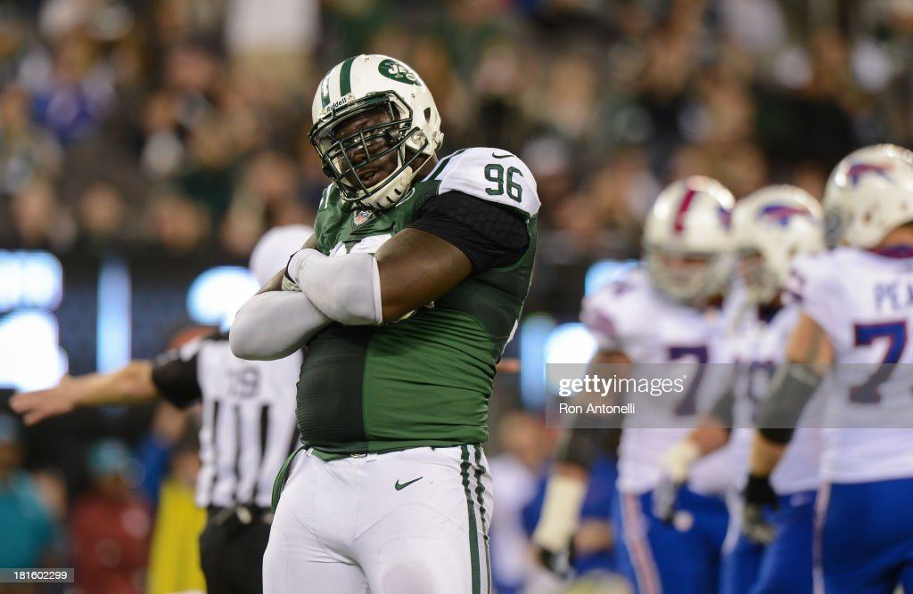 Defensive end Muhammad Wilkerson #96 of the New York Jets celebrates after he sacks quarterback EJ Manuel #3 of the Buffalo Bills in the 2nd half of the Jets 27-20 win over the Buffalo Bills at MetLife Stadium on September 22, 2013 in East Rutherford, New Jersey.
