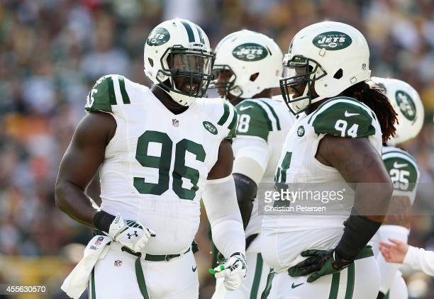 Defensive end Muhammad Wilkerson of the New York Jets talks with nose tackle Damon Harrison during the NFL game against the Green Bay Packers at...