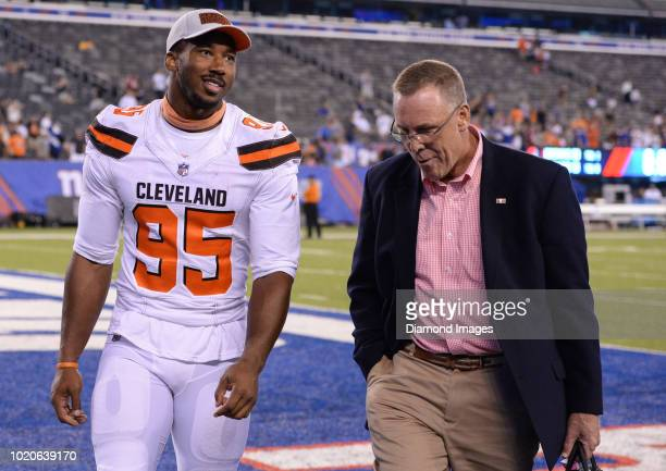 Defensive end Myles Garrett general manager John Dorsey of the Cleveland Browns talk as they walk off the field after a preseason game against the...