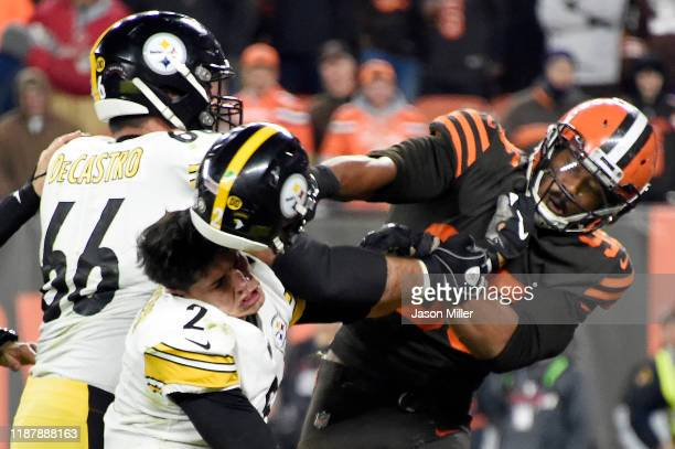 Defensive end Myles Garrett of the Cleveland Browns hits Quarterback Mason Rudolph of the Pittsburgh Steelers over the head with his helmet during...