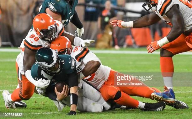 Defensive end Myles Garrett of the Cleveland Browns sacks quarterback Nick Foles of the Philadelphia Eagles in the second quarter of a preseason game...