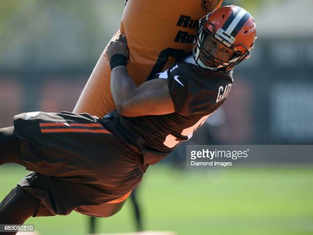 Defensive end Myles Garrett of the Cleveland Browns takes part in a tackling drill during a rookie mini camp practice on May 13 2017 at the Cleveland...