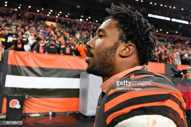 Defensive end Myles Garrett of the Cleveland Browns walks off the field after being ejected for hitting quarterback Mason Rudolph of the Pittsburgh...