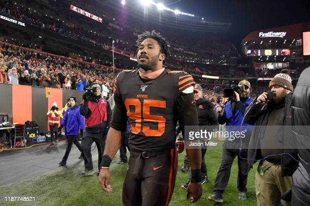 Defensive end Myles Garrett of the Cleveland Browns walks off the field after being ejected from the game during the second half at FirstEnergy...