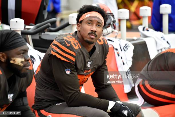 Defensive end Myles Garrett of the Cleveland Browns watches the final minutes against the Tennessee Titans from the bench at FirstEnergy Stadium on...