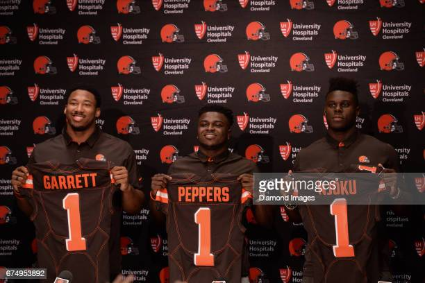 Defensive end Myles Garrett safety Jabrill Peppers and tight end David Njoku of the Cleveland Browns pose for pictures holding their draft day...