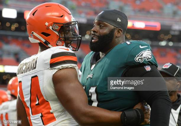 Defensive end Nate Orchard of the Cleveland Browns and offensive tackle Jason Peters of the Philadelphia Eagles embrace prior to a preseason game on...