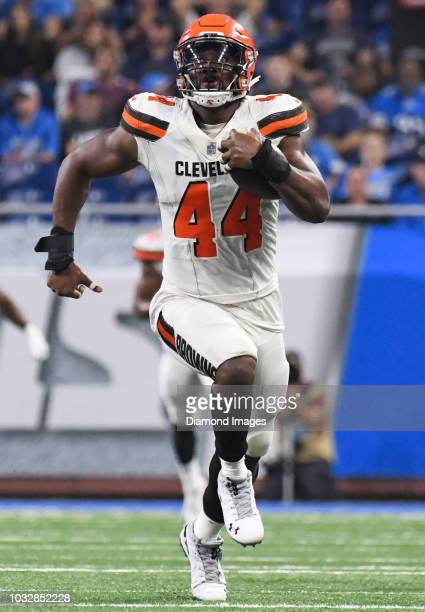 Defensive end Nate Orchard of the Cleveland Browns returns an interception in the second quarter of a preseason game against the Detroit Lions on...