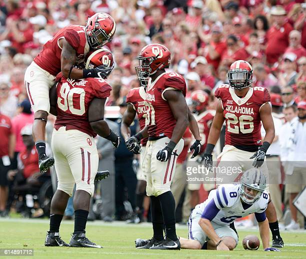 Defensive end Neville Gallimore linebacker Kapri Doucet and linebacker Ogbonnia Okoronkwo of the Oklahoma Sooners celebrate a sack of quarterback Joe...