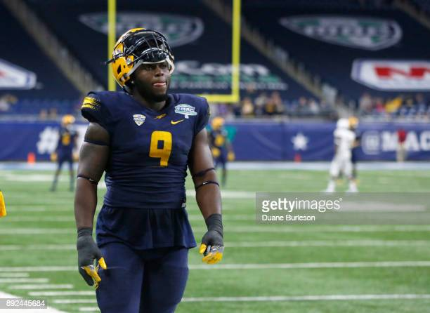 Defensive end Olasunkanmi Adeniyi of the Toledo Rockets leaves the field after being ejected from the game in the fourth quarter after he was called...