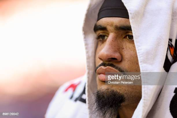 Defensive end Olivier Vernon of the New York Giants looks on from the benc in the first half of the NFL game against the Arizona Cardinals at...
