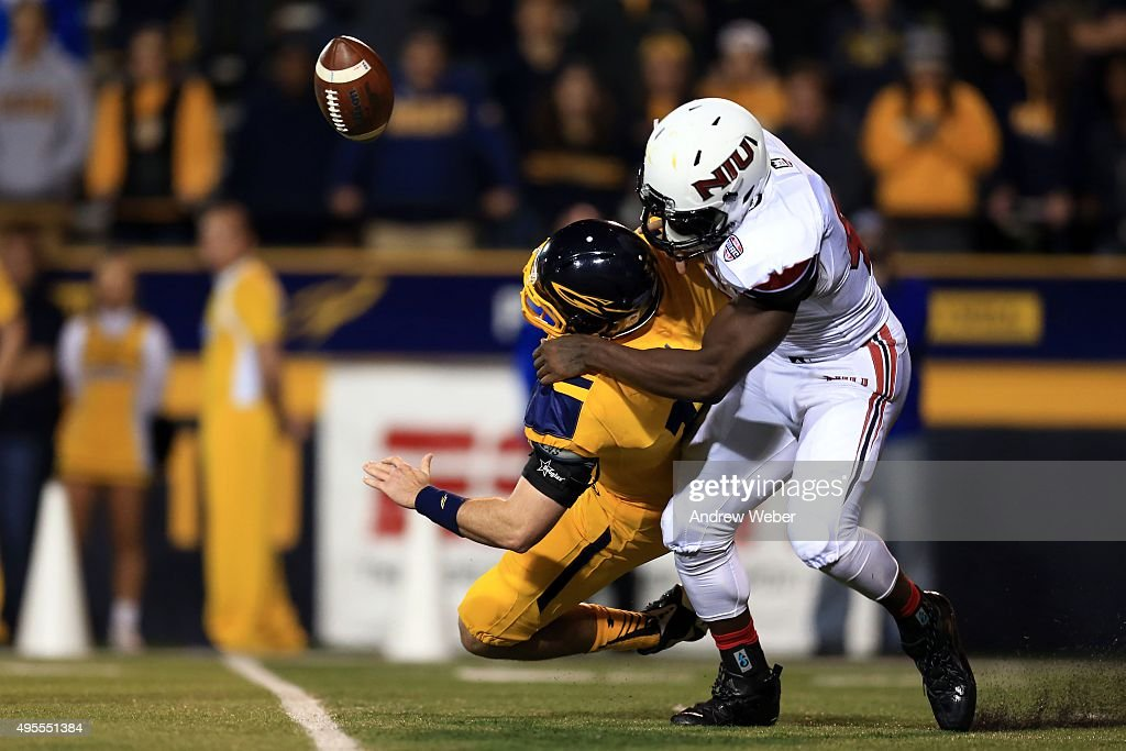 Defensive end Perez Ford #44 of the Northern Illinois Huskies sacks quarterback Phillip Ely #12 of the Toledo Rockets during the third quarter at Glass Bowl on November 3, 2015 in Toledo, Ohio.
