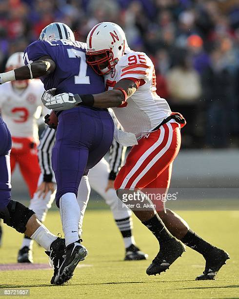 Defensive end Pierre Allen of the Nebraska Cornhuskers tackles running back Lamark Brown of the Kansas State Wildcats for a loss during the second...